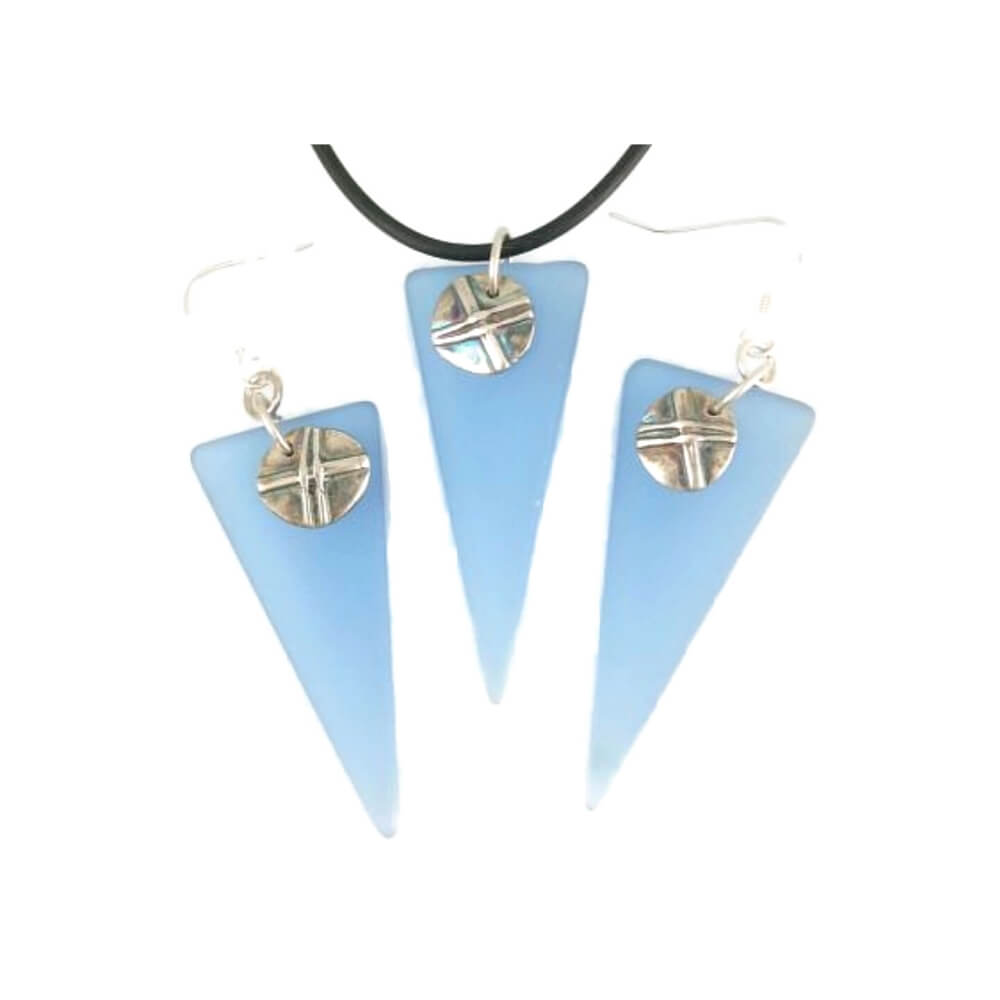 Pendant and earrings in triangular shaped blue glass, each featuring a button-like silver accent circle with a raised x pattern.
