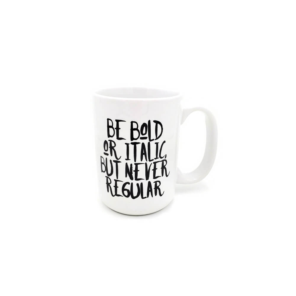 White coffee mug with black lettering urging the reader to Be bold or italic, but never regular.