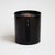 "Candle with wood wick inside black canister with the words ""fern + rain"" in white lower case letters."