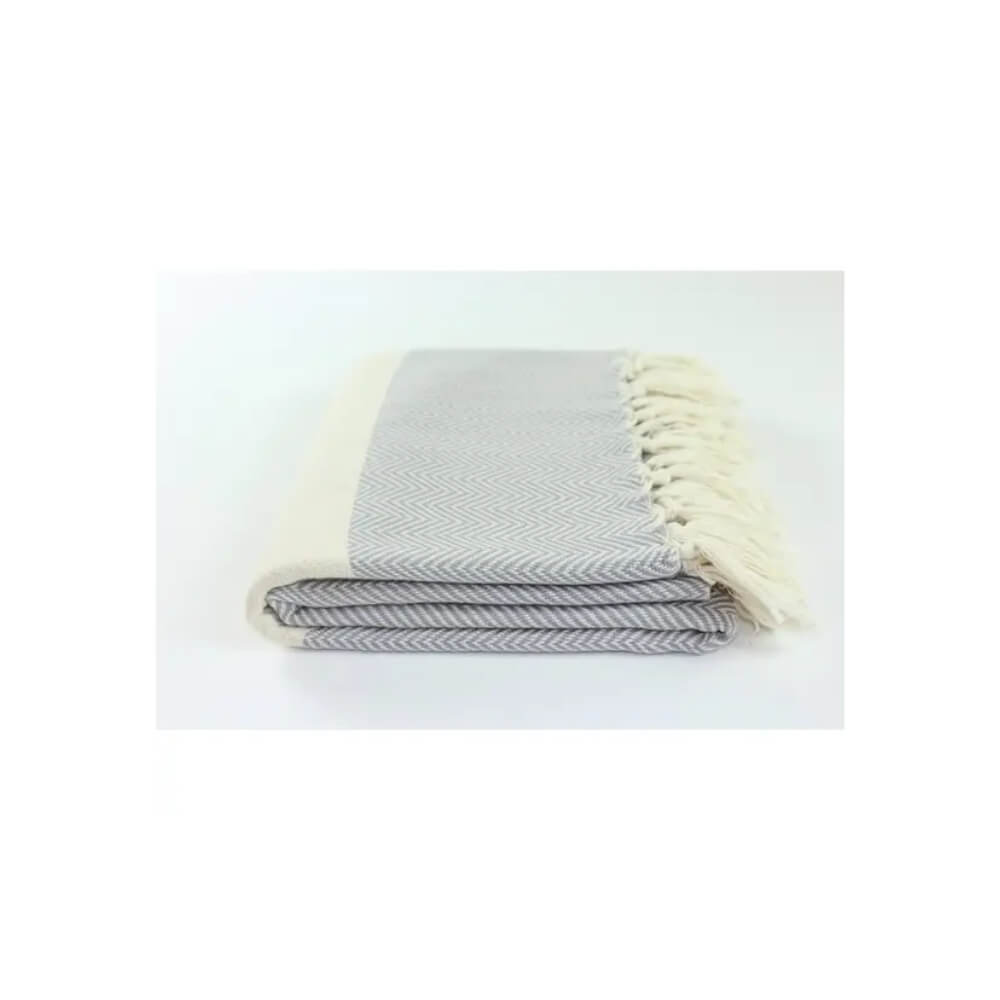 Gray and beige herringbone woven towel with beige stripe and hand-tied beige fringe