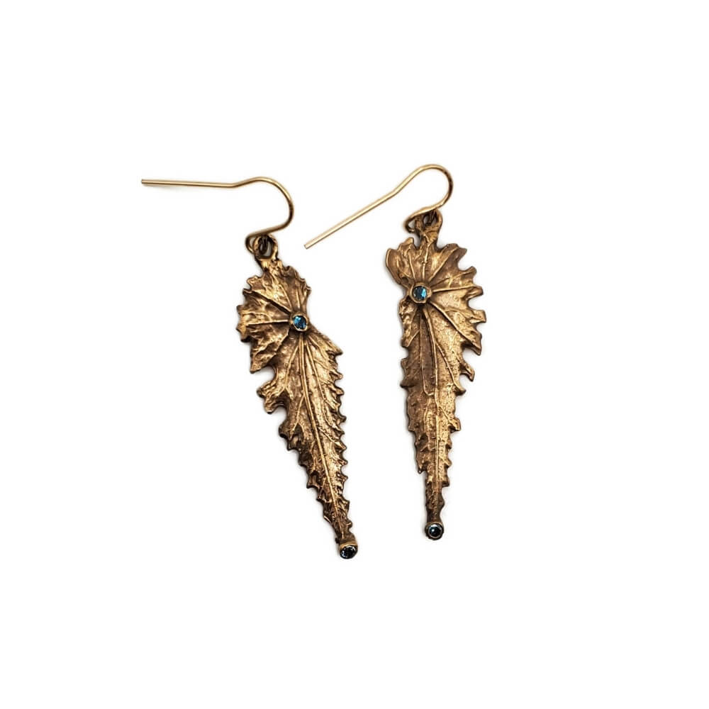 Golden colored bronze leaf-textured earrings with a small blue colored stone in each.
