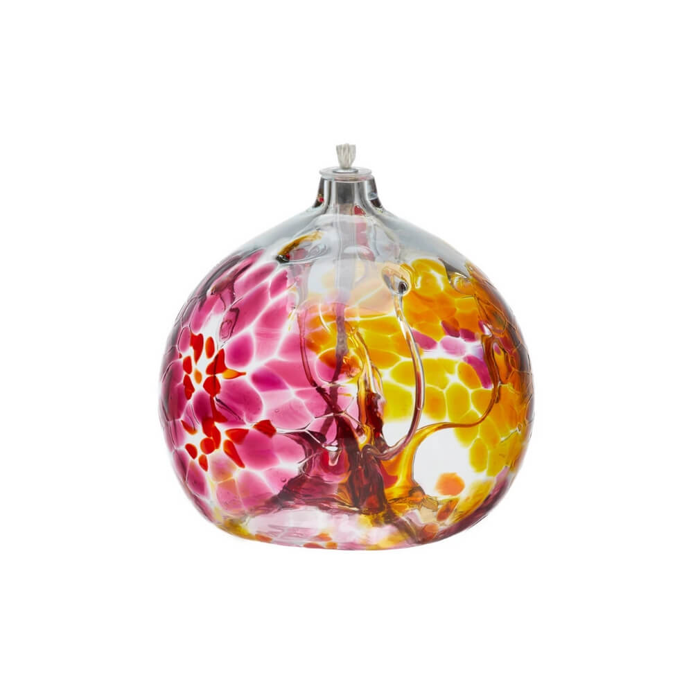 Round, hand-blown, clear glass contemporary oil lamp with deep transparent pink and yellow.