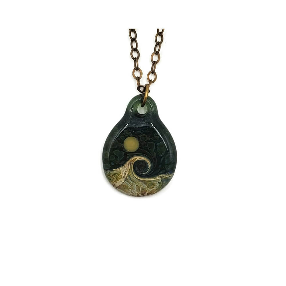 A round, translucent green pendant is suspended on a bronze colored chain. The pendant features a wave in shades of brown, green, yellow, and beige. The sky is dark, mottle colors and there is a yellow green moon in the sky.