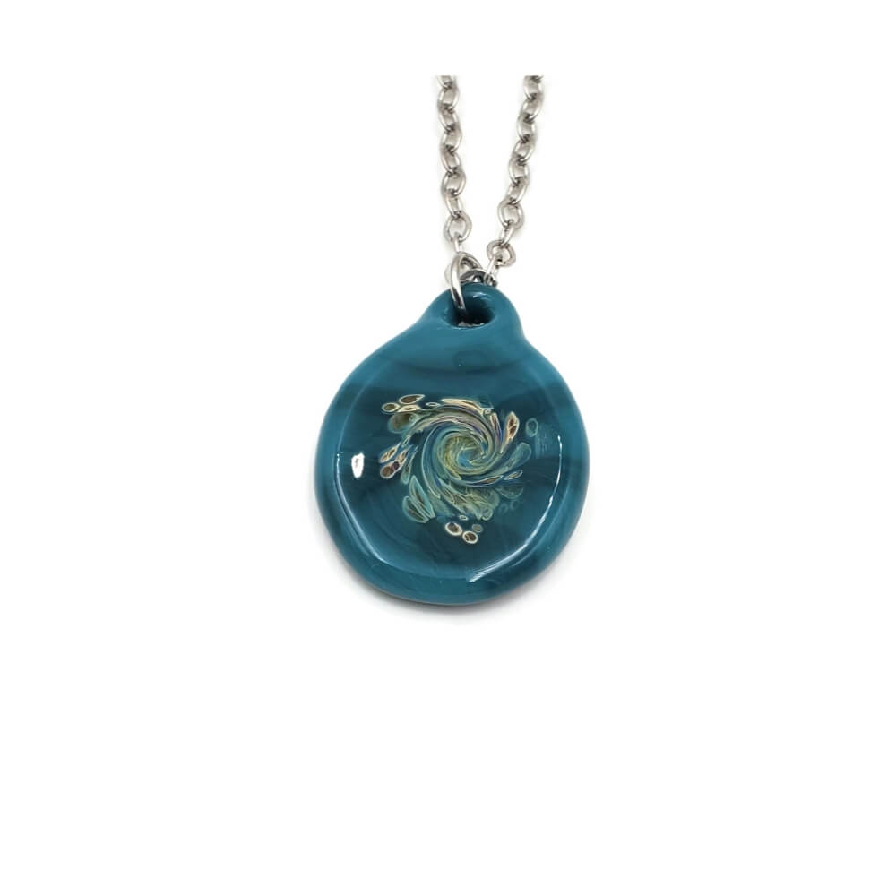 Turquoise pendant hanging on a silver tone chain. The pendant features swirling colors of sage green and creamy yellow.