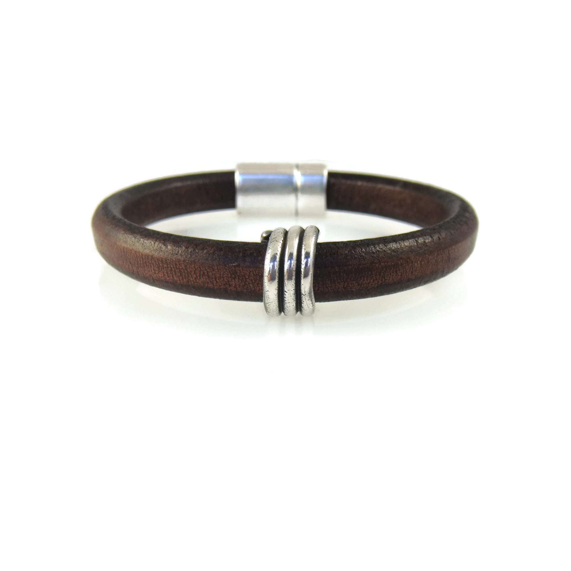 Brown leather bracelet with magnetic clasp and a wrapped silver bead made from fine silver clay.