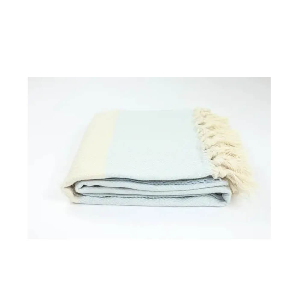 Light blue and beige herringbone woven towel with beige stripe and hand-tied beige fringe