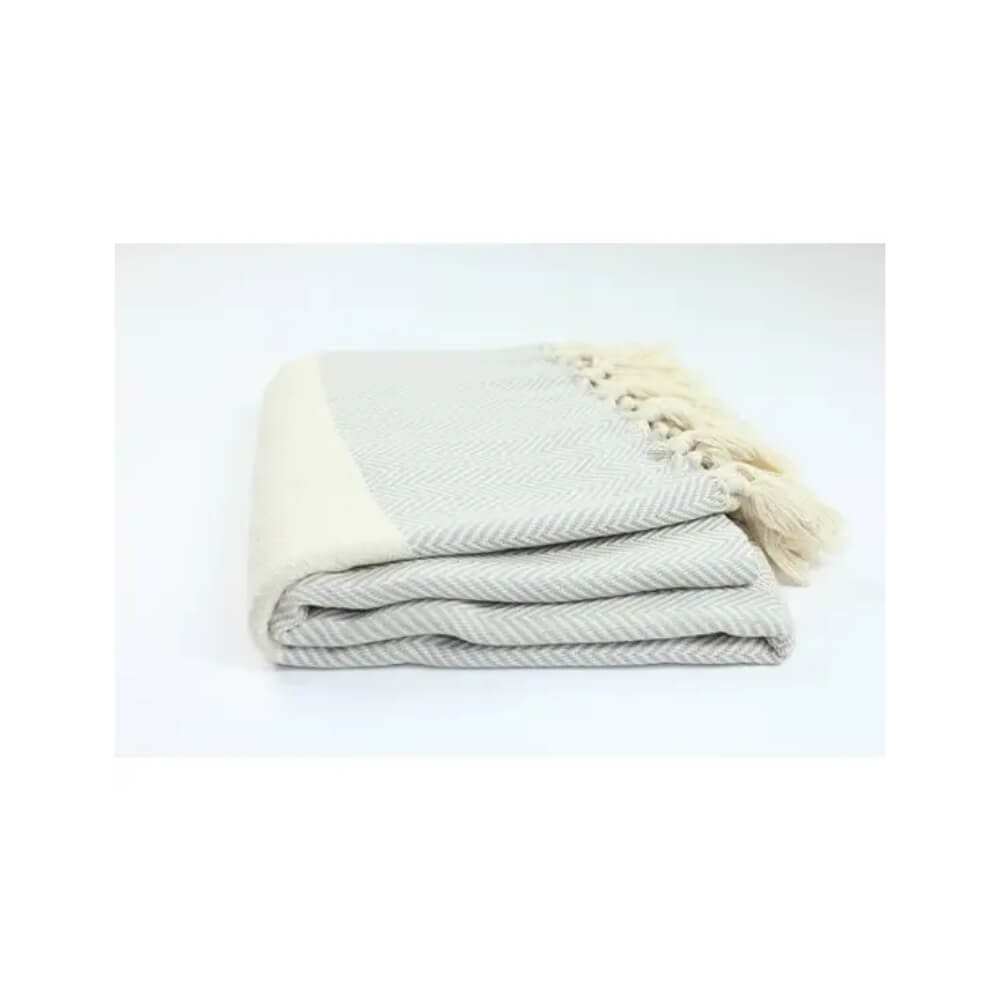 Light Gray and beige herringbone woven towel with beige stripe and hand-tied beige fringe