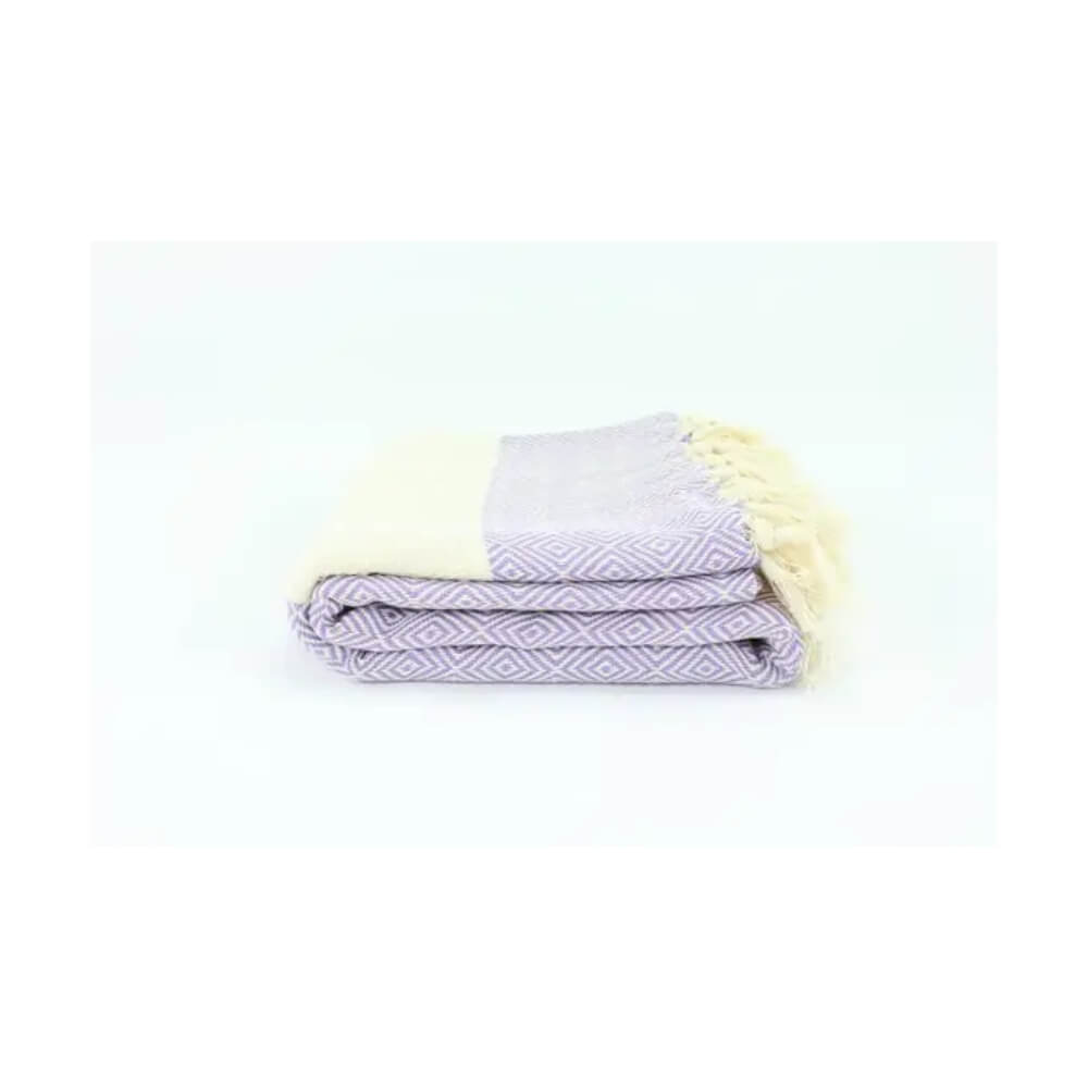 Lilac and beige diamond pattern woven towel with beige panel near each end and hand tied beige fringe.