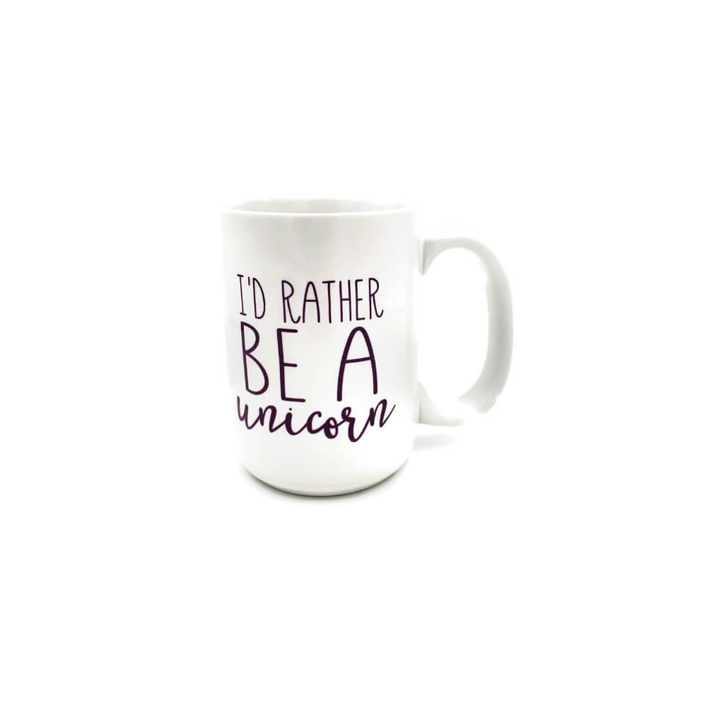 "White ceramic mug with purple lettering reading ""I'd Rather be a Unicorn""."