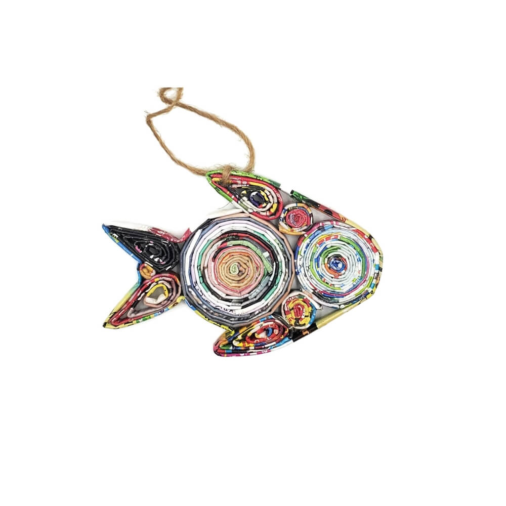 A hanging paper ornament made from brightly colored recycled folded magazine paper and coiled into the shape of a fish.