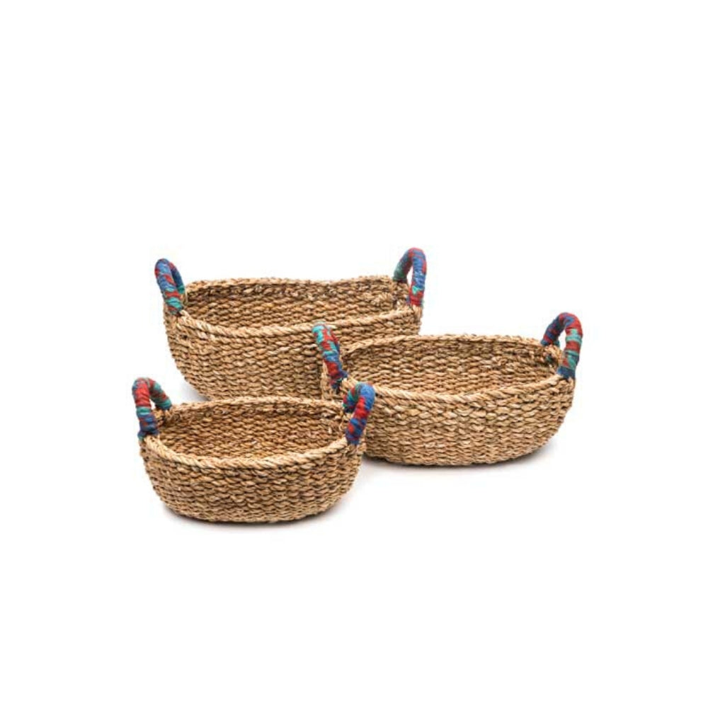 Set of three woven table baskets handcrafted with brightly colored, recycled sari wrapped handles.