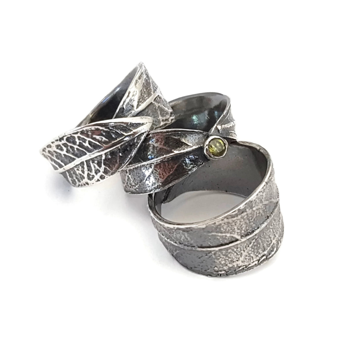 Three different styles of fine silver wrap rings made from ArtClay Silver metal clay and textured using molds made from leaves.