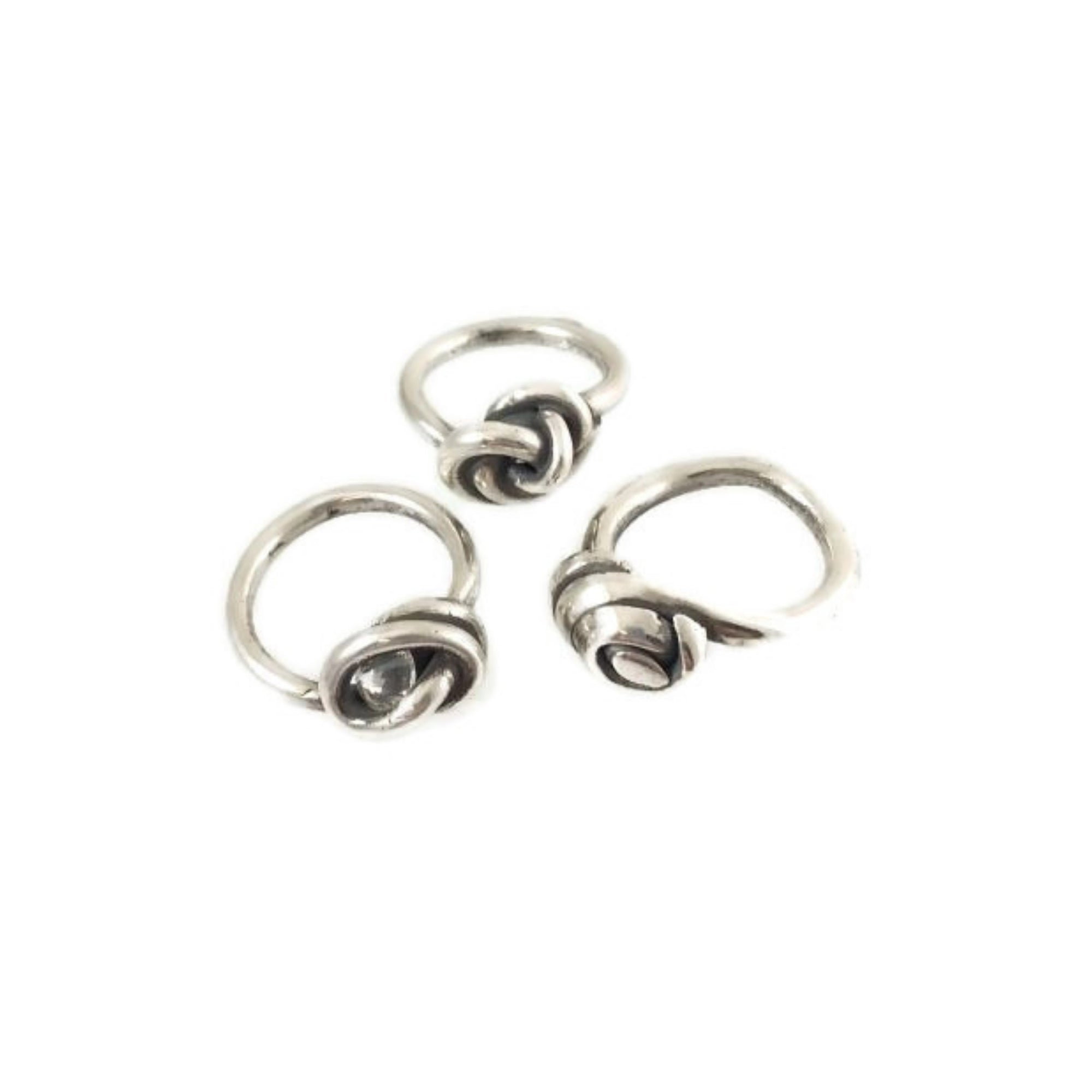 Three fine silver rings made from silver metal clay and wrapped in variously intricate knots.