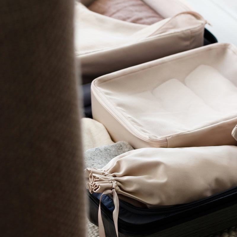 how to pack a suitcase with packing cubes