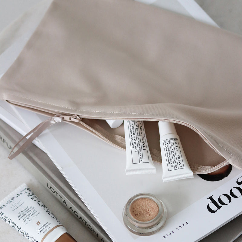 beige travel bag for toiletries