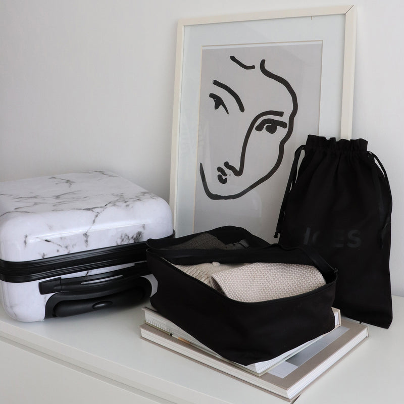black shoe bag and packing cube