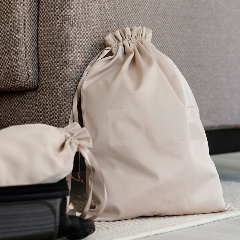 beige laundry bag for organized packing