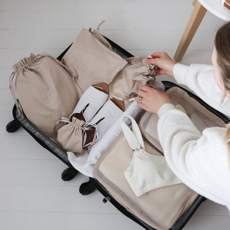 how to pack a suitcase with organizers
