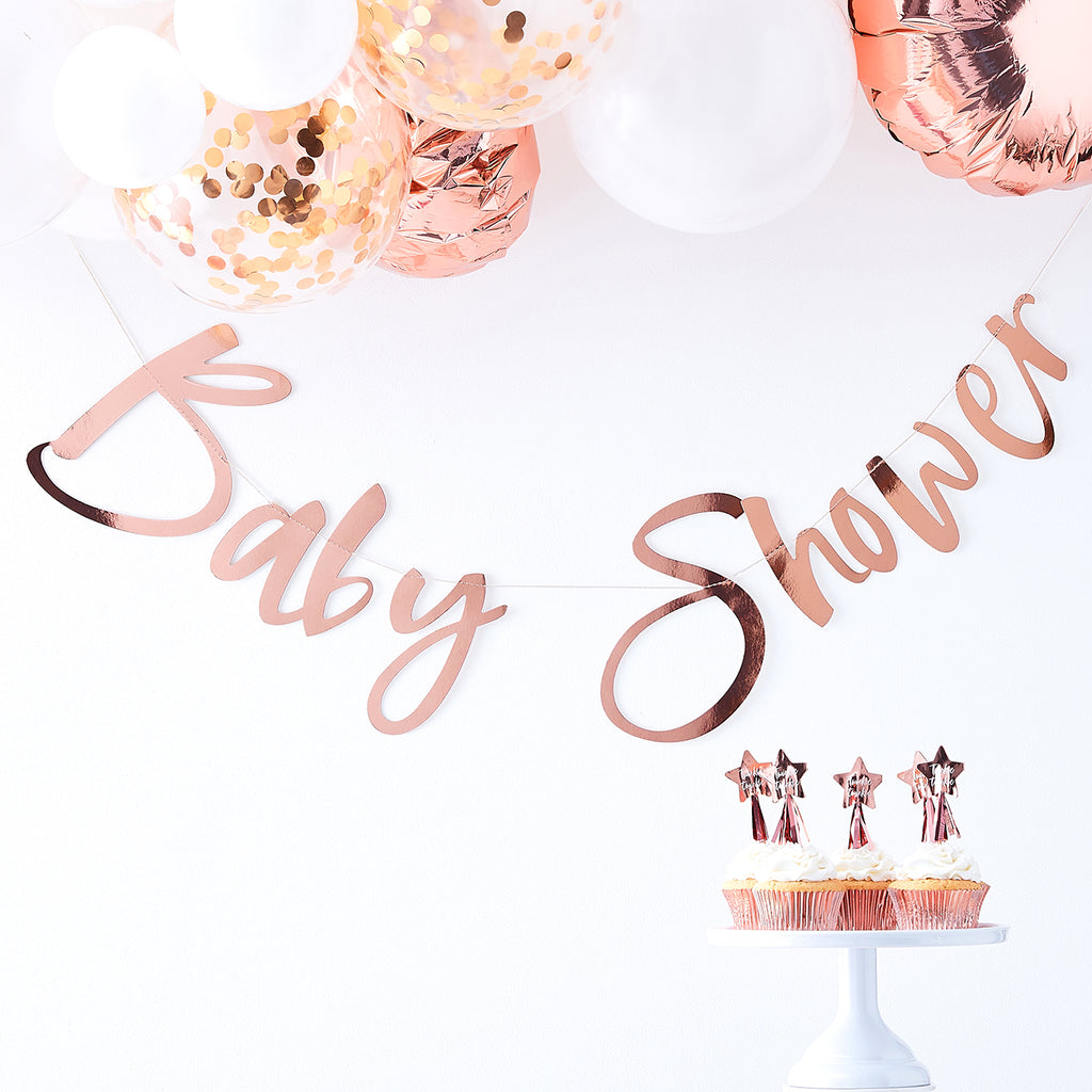 Décoration de baby shower fille rose gold : guirlande et ballons confettis
