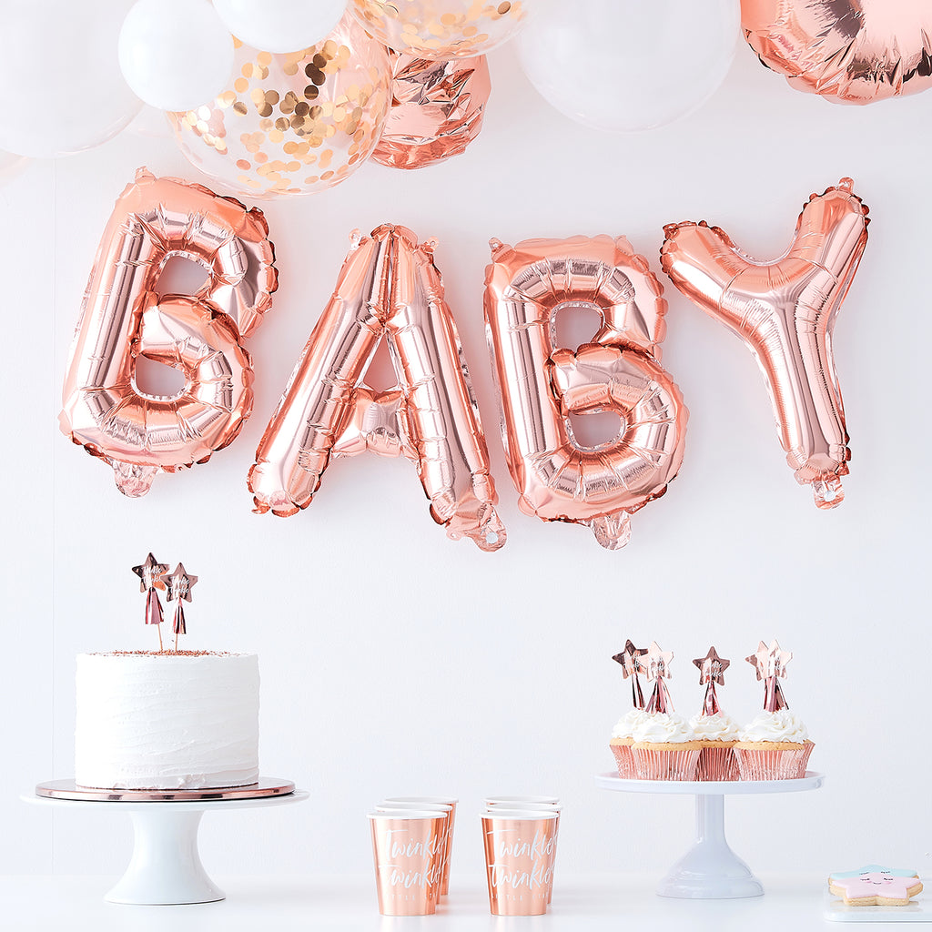 Idée decoration candy bar de baby shower fille or rose avec ballon baby