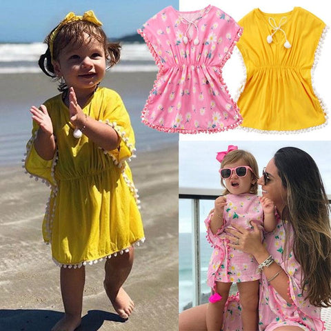 Image of Beach Dress - Baby Girl Wearing a Tassel Beach Dress standing on the beach -Damn-Skippy-Wear