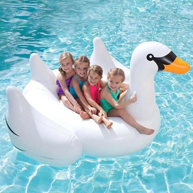 Kids floating on a Charming Swan Inflatable Bed Pool Floats