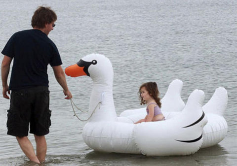 Image of Father pulling his daughter on a Charming Swan Inflatable Bed Pool Floats