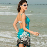 Image of Beach Dress - Woman on a Beach Wearing a Contouring Backless Beach Dress