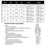 Image of Beach Dress - Woman on a Beach Wearing a Contouring Backless Beach Dress Size Chart