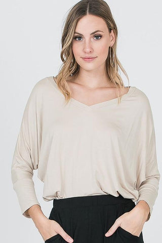 https://hopechestboutique.com/collections/tops/products/dolman-v-neck-3-4-sleeve-top