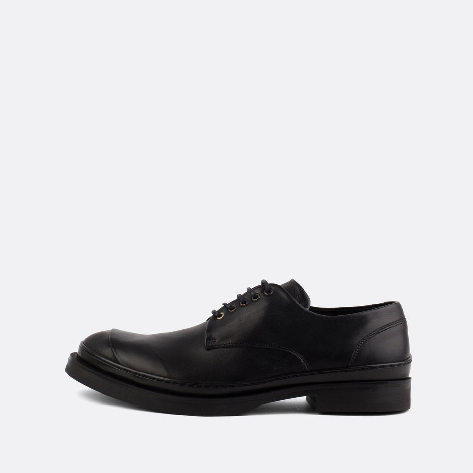 Black leather derby shoes.