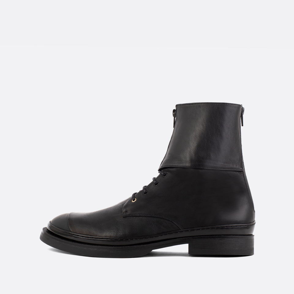 Unique black leather lace-up boots with zipper detail.