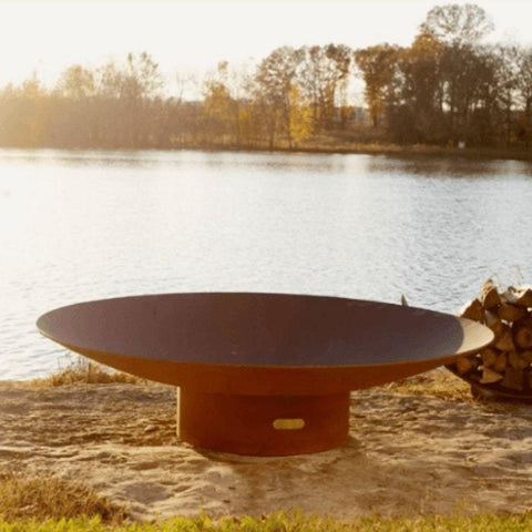 "Asia 72"" Fire Pit by Fire Pit Art with Pond and Tress Background"