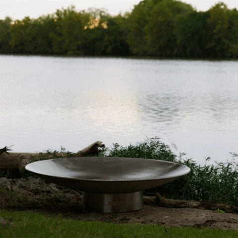 "Bella Vita 70"" Stainless Steel Fire Pit by Fire Pit Art with Big Pond Background"