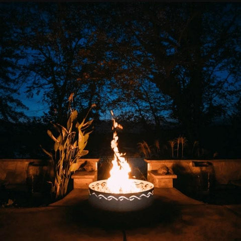 Fire Surfer Stainless Steel Fire Pit by Fire Pit Art with Plants and Tress Background