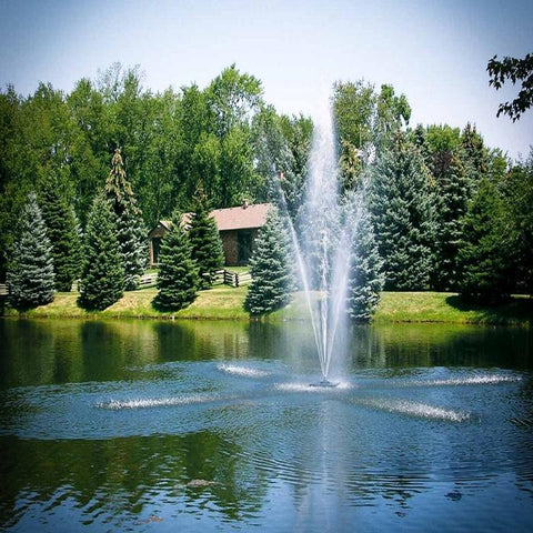 Scott Aerator Clover Pond Fountain 1.5HP 230V Shooting Water with Pine Trees Background