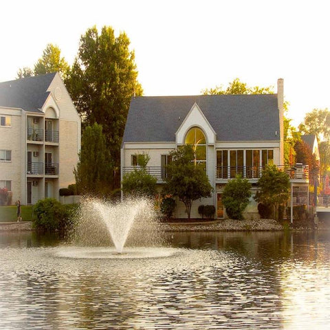 Image of the Scott Aerator DA-20 Display Fountain Aerator 2HP Shooting Water at the Pond with Houses