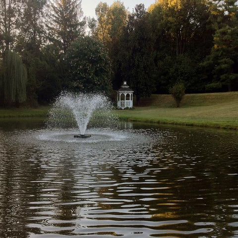 Image of the Scott Aerator DA-20 Display Fountain Aerator 1HP 230V Shooting Water at the Pond with Gazebo and Tress