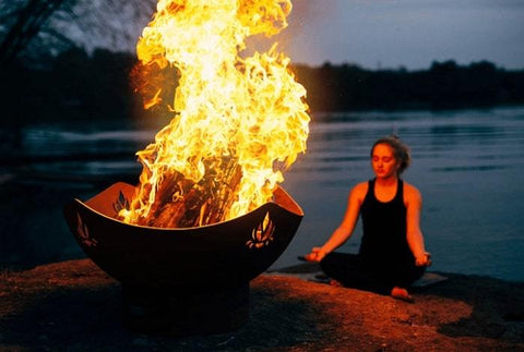 "Namaste 36"" Steel Fire Pit by Fire Pit Art with Big Fire and a Woman Sitting"