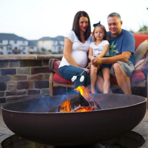 Ohio Flame Patriot Fire Pit with a Family of Three as a Background
