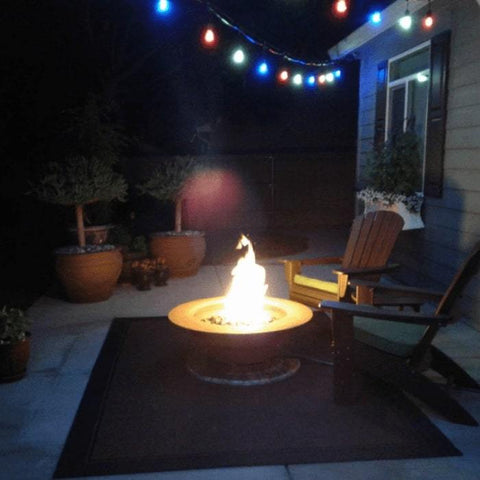 Saturn Steel Fire Pit with Lid by Fire Pit Art in Outside the House with Two Chairs