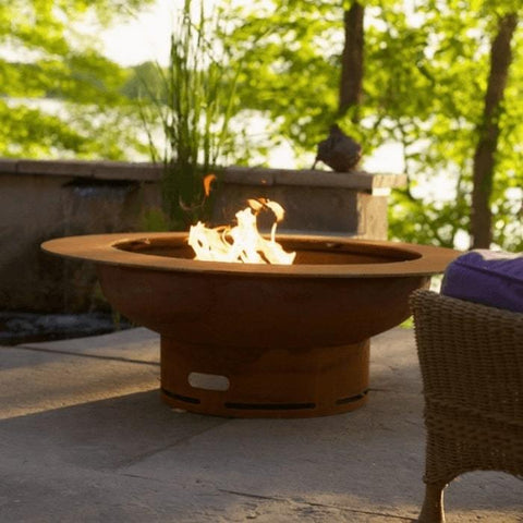 Saturn Steel Fire Pit by Fire Pit Art with Tress Background