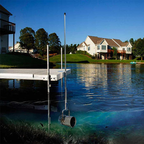 Image of the Scott Aerator Dock Mount Aquasweep Muck Blaster Under the Water with Houses and a Dock
