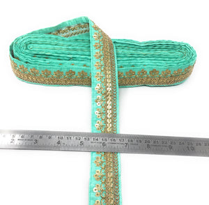 Turquoise Fabric Border With Gold Sequins Embroidery