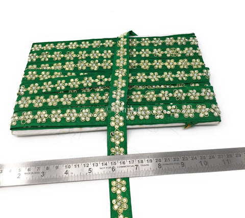 Image of 9 mtr lace border trim Dark Green flower, leaves  in stone, center in pearl