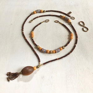 Hand painted brown yellow Adinkra African beads with vintage olive wood pendant long necklace. Cristina Tamames Jewelry Designer