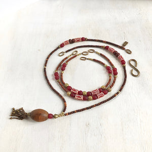 Hand painted red Adinkra African beads with vintage olive wood pendant long necklace. Cristina Tamames Jewelry Designer