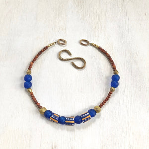 Hand painted blue yellow African beads with vintage olive wood pendant long necklace. Cristina Tamames Jewelry Designer