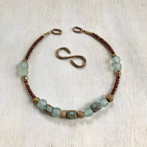 Hand painted aqua Adinkra African beads with vintage olive wood pendant long necklace. Cristina Tamames Jewelry Designer