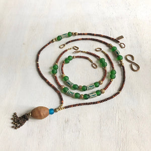 Hand painted green Adinkra African beads with vintage olive wood pendant long necklace. Cristina Tamames Jewelry Designer